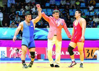 Wrestler Yazdani sacos de ouro do Irã no Jogos Asiáticos